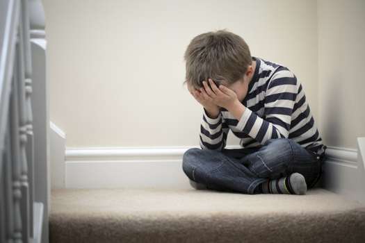 A new report says about 17,000 South Dakota children are facing more obstacles in their young lives as a result of a parent's incarceration. (iStockphoto)
