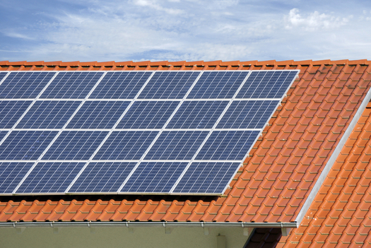 Advocates say a proposal by Arizona Public Service to cut net-metering rates in Arizona could cripple the state�s rooftop solar power industry. (francis49/iStockphoto)