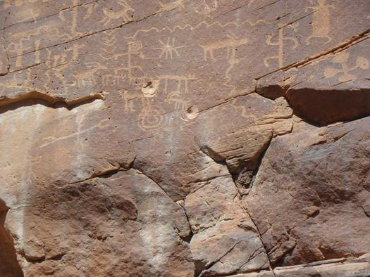 Bullet holes left by vandals in the rock at Gold Butte, marring ancient petroglyphs. (Christian Gerlach/Sierra Club)
