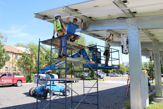 "Workers install a new solar panel array at the ""Home on the Range"" building in Billings. (Northern Plains Resource Council)"