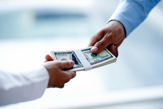 A new study shows that most Americans don't know enough about how to handle their money. (Dragon/iStockphoto)