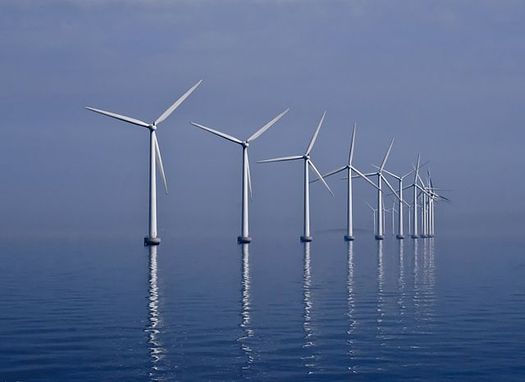 As state lawmakers consider a measure to boost wind energy, a new report shows the Regional Greenhouse Gas Initiative is producing major carbon pollution drops in the Bay State and region. (Kim Hansen)