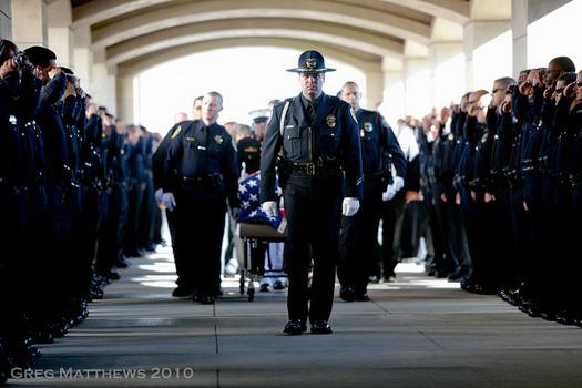 Nationally, 67 federal, state, and local officers were killed on the job during the first half of 2016. (Greg Matthews/Flickr)