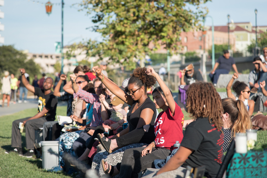 Attendees show their support at the Night Out For Safety and Liberation in Oakland in 2015, a rival event to the National Night Out. (Brooke Anderson)