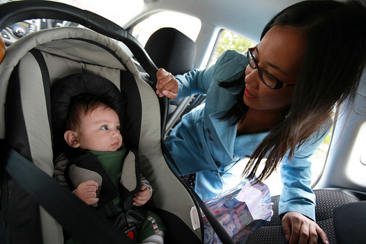Safety experts recommend that infants and toddlers ride in a rear-facing seat until they are at least two years old. (Raylene Gutierrez/Flickr)