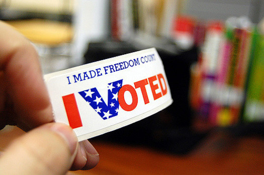 Iowans can register to vote today by bringing identification and proof of residency to their polling location. (Kelly Minars/Flickr)