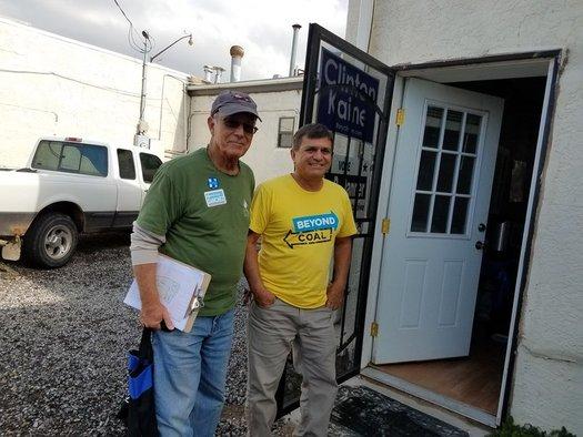 Sierra Club volunteers Tom Gorman and Michael Melendrez canvas the neighborhood encouraging residents to vote. (Susan Martin/Sierra Club Rio Grande Chapter)