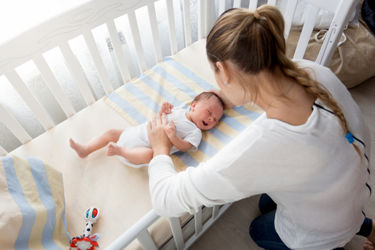 New guidelines say parents should put infants to sleep on their backs in an uncluttered crib. (artfoliophoto/iStockphoto)