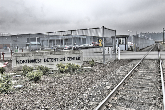 The group NWDC Resistance says the Northwest Detention Center is over capacity and questions the conditions and treatment of immigrants held there. (Seattle Globalist/Flickr)