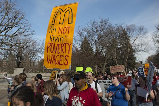 Twenty cities and dozens of large companies have raised their minimum wages. (Fibonacci Blue/flickr.com)