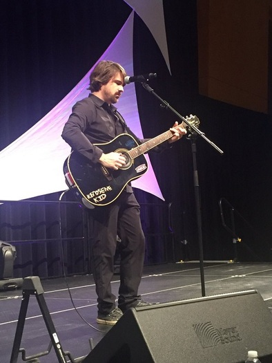Singer and songwriter Jimmy Wayne, on stage in Indianapolis, spreads the message about the thousands of children in foster care, and what others can do to help them. (Jimmy Wayne)