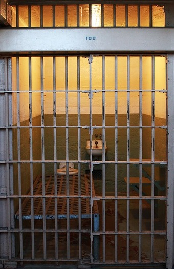 A new report says the number of people incarcerated could be cut drastically without endangering the public. (LisaRedfern/Pixabay)