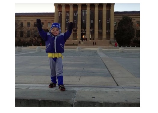 "Matt Brown was born with heart defects, but his family says medical research has meant he can climb to the top of the steps featured in the movie ""Rocky."" (YouTube/The Brown Family)"