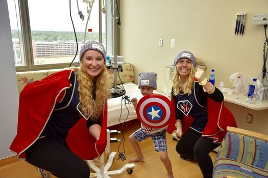 Maryland college students dress as superheroes to entertain sick children. (lym.org)