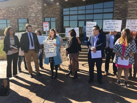 Protesters opposing President-elect Trump's Cabinet picks gathered outside Sen. Dean Heller's office on Tuesday. (Nevada State Education Assn.)