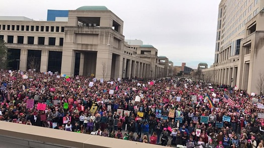 Thousands participated in marches for human rights in Illinois this weekend, and were urged to stay involved in their communities and in politics. (V. Carter)