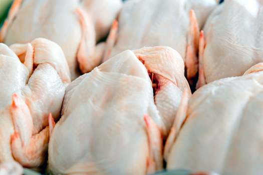 Poultry processing is a $4 billion a year industry in Arkansas, employing more than 40,000 people. (nd3000/iStockphoto)