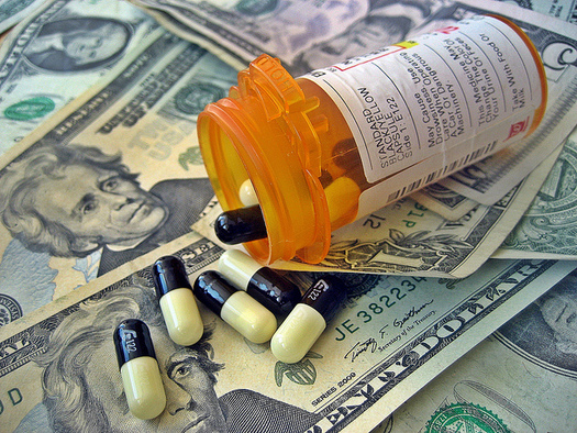 Many older Iowans are squeezed by increasing health care and prescription drug costs. (Images Money/Flickr)