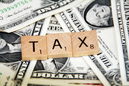 Some analysts say a proposed income tax cut only would benefit wealthy Nebraskans. (401(k) 2012/Flickr)