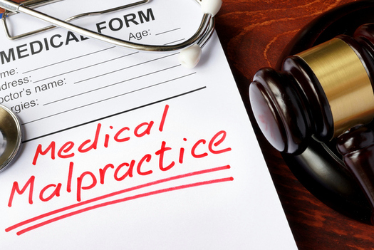 A new poll shows opposition in several primarily Republican states to a bill in Congress that would restrict a patient�s ability to sue for malpractice. (designer491/iStockphoto)