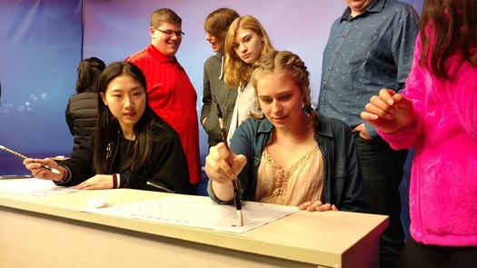 Indiana high school student Haley Johnson gets a lesson in Chinese calligraphy. (V. Carter)