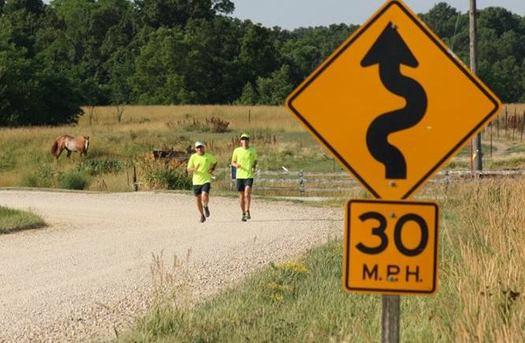 Daren Schumaker and Dennis Lee of Cedar Rapids have spent eight years running marathons in each of Iowa's counties. (Team 99 Counties)