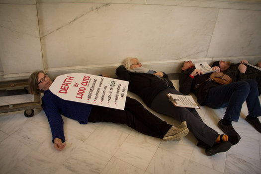 "Opponents of the American Health Care Act staged a ""die-in"" at Gov. Chris Sununu's office to send a message to visiting U.S. HHS Secretary Tom Price. (Jeff Kramer/Rights & Democracy NH)"