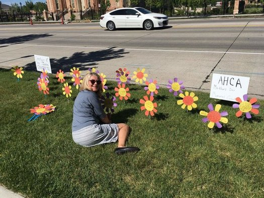 Activists planted more than 300 paper flowers outside the offices of Utah's congressional delegation yesterday, each with a testimonial from a resident concerned about the American Health Care Act. (Courtney Henderson Marden)