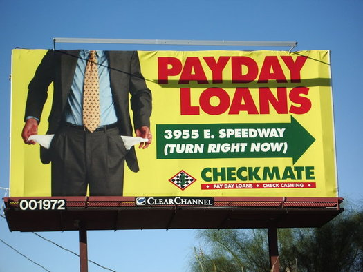 A new report says there's a reason payday lenders proliferate near military bases, where young families might not be financially savvy. (Kelly Griffith/Center for Economic Integrity)