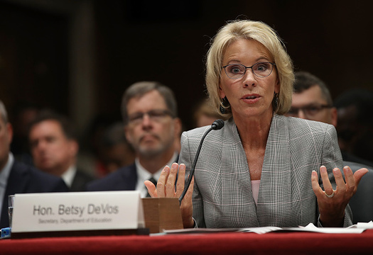 Washington and 18 other states are suing U.S. Education Secretary Betsy DeVos for failing to implement regulations on for-profit colleges as scheduled on July 1. (Win McNamee/Getty Images)