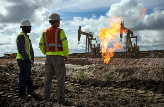 "Excess methane gas is ""flared"" or burned near an oil well site. Current EPA rules require new or modified wells to capture the gas rather than vent it into the atmosphere. (Burton/GettyImages)"