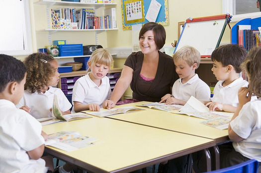 Districts nationally lose more than $7 billion a year because of teacher turnover. (Ilmicrofono Oggiono/Flickr)