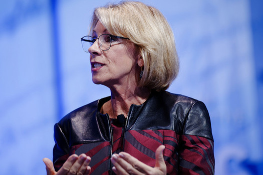 U.S. Education Secretary Betsy DeVos backs a Trump administration budget proposal that would cut total federal spending on public schools by $9 billion. (Michael Vadon/Flickr)