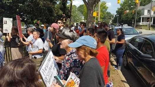 "People chant, ""No Borders, no Walls, Sanctuary for All!"" in Raleigh on Tuesday after the Trump administration announcement to end DACA. (El Pueblo)"