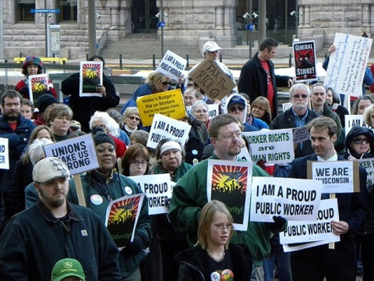 Union workers at a 2011 Minneapolis rally. AFSCME Council 5 represents 43,000 Minnesota public-sector employees. (Fibonacci Blue/Flickr)