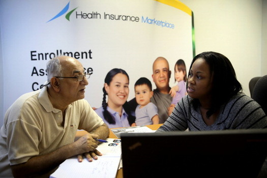 The White House has severely cut the funding for community groups, often called Navigators, that help people sign up for health coverage under the Affordable Care Act. (Raedle/Getty Images)