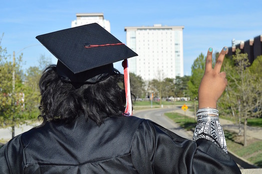 Latina women need two additional degrees to get median earnings similar to white men, according to a new report. (actaylorjr/Pixabay)