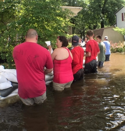 Volunteers packed thousands of sandbags this summer when thousands of homes were flooding in the northern part of the state. (V. Carter)