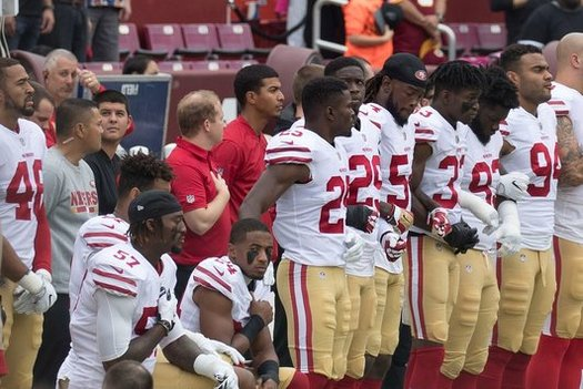 """The """"taking a knee"""" protest movement is becoming more popular in the NFL. (Keith Allison/Flickr)"""