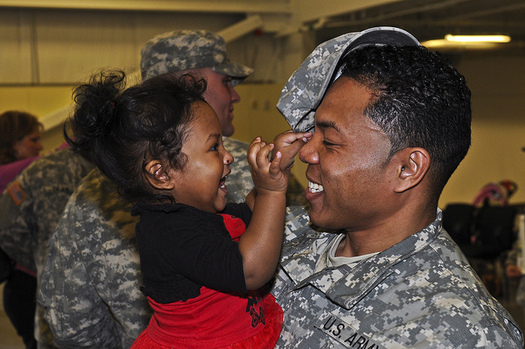 Increasing opportunities for parents help create economic stability for families of all races. (Pfc. Loren Cook/Flickr)