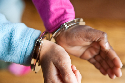 A new report says 100 percent of New York City public-school students ages 5 to 12 who were handcuffed by police were children of color. (Steven Depolo/Flickr)