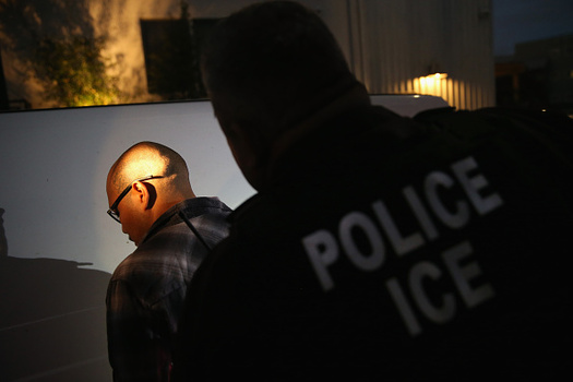 """A massive raid that was planned for September, known as """"Operation Mega,"""" targeted more than 8,000 undocumented immigrants across the country. (John Moore/Getty Images)"""