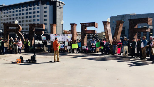 """Protesters in Reno called on Gov. Brian Sandoval to sign the """"Still In"""" pledge to fight climate change.(One Source Network)"""