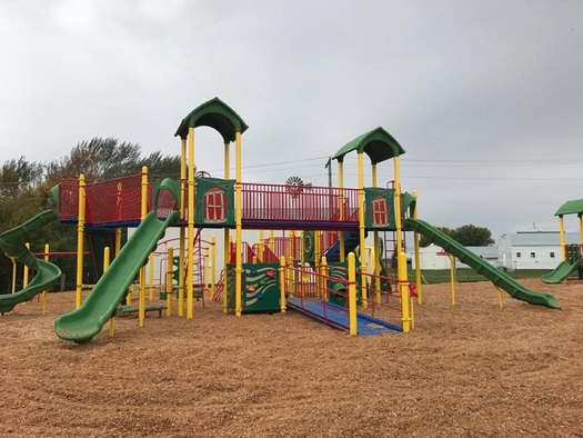 The new accessible playground at the Clinton-Graceville-Beardsley grade school, funded in part by GiveMN donors, features a wood-chip play surface and interactive equipment. (School District 2888)