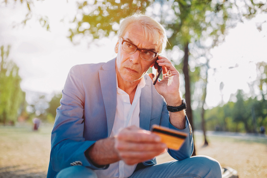 """Con artists often seek out seniors during the holiday season with scams demanding they pay bogus tax bills, false pleas from """"relatives"""" for money or other deceptive schemes. (Demitirov/GettyImages)"""