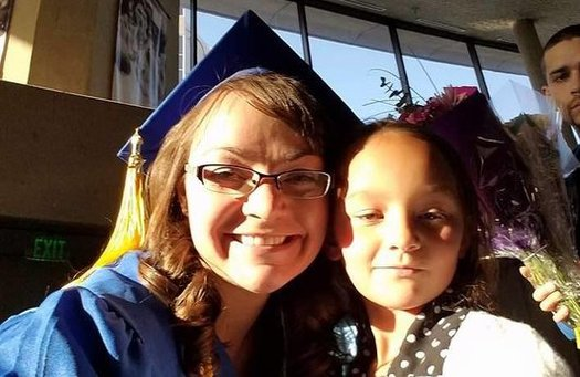 "Jessica Price, a participant in the ""Getting Ahead"" program, at her community college graduation, with her daughter Kiera. (Jessica Price)"
