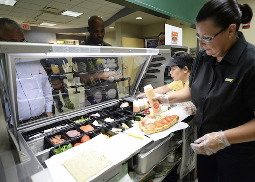 Assistant managers in fast food restaurants may work 60 hours, but many get no overtime pay. (Staff Sgt. Kevin Iinuma/US Air Force photo)