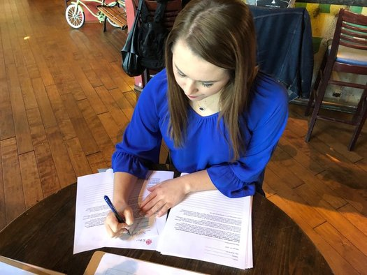 Some people visited Raleigh businesses Thursday to hand-write letters outlining their opposition to legislation that allows local officers to enforce federal immigration law. (Trey Roberts)