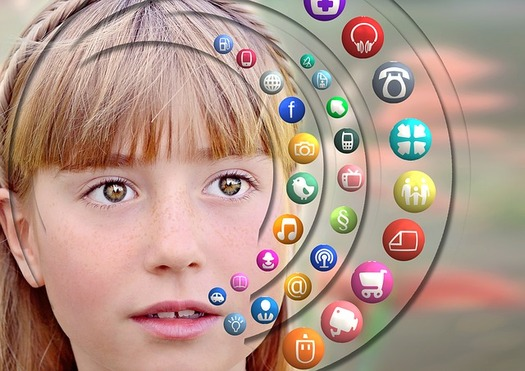 Kids spend an average of nine hours a day in front of a digital or media device. (Kevin Jarrett/Flickr)