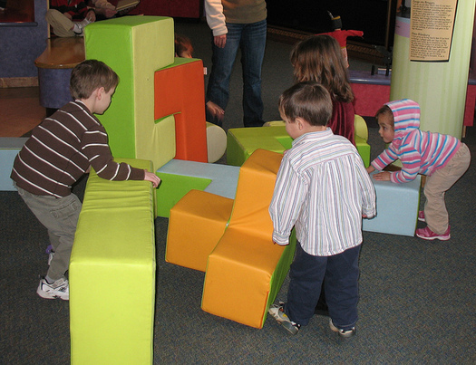 """The organization Neighborhoods Matter in Spokane, WA uses """"play and learns"""" to develop kids social skills. (James Emery/Flickr)"""